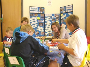 Staff from Sure Start providing an activity for children at the All Saints Church Summer Fair